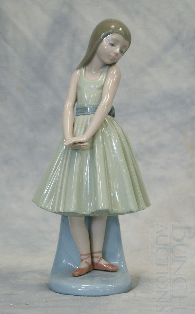 3048B: Lladro girl in green dress figurine, #C-13 F, 10