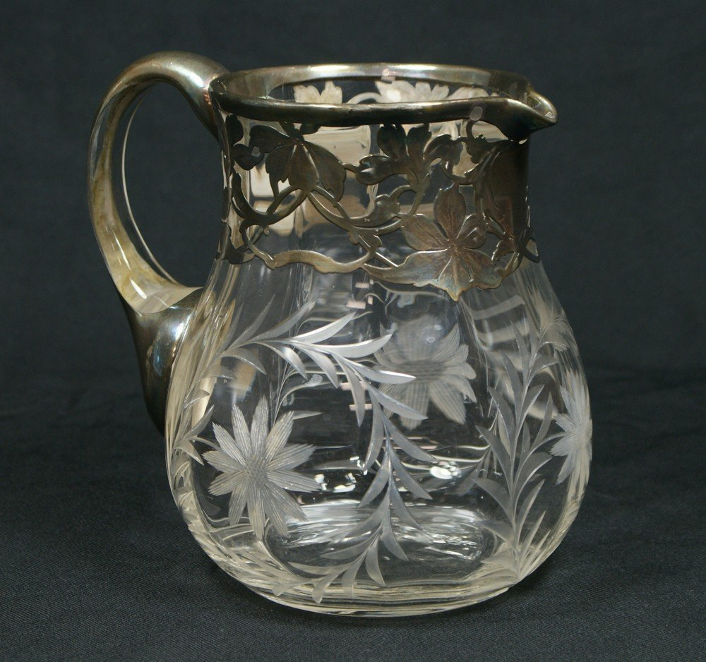 4069: Unmarked silver overlay engraved glass pitcher, 7