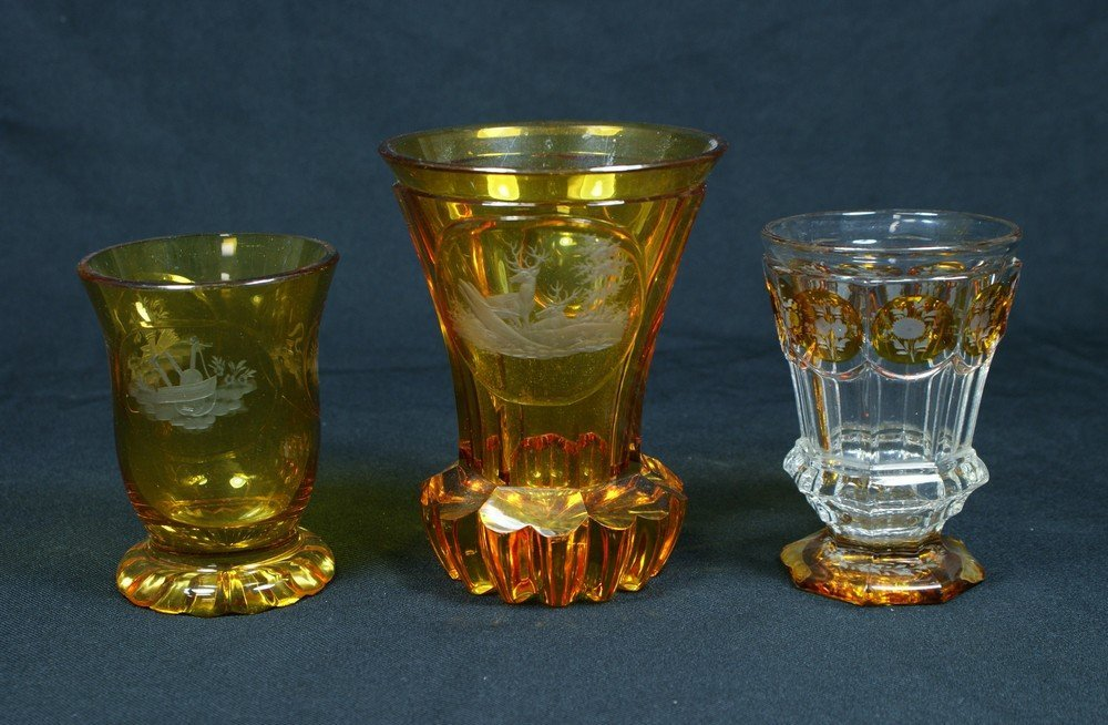 4192: (3) etched amber Bohemian glass beakers, tallest
