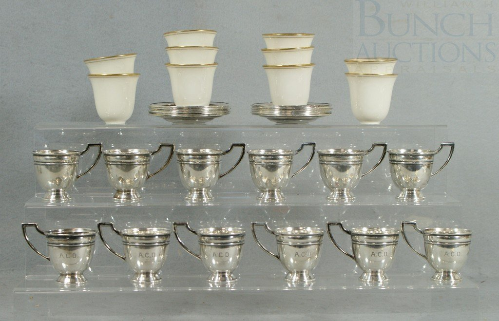 4027: 12 sterling silver demitasse cup frames and sauce
