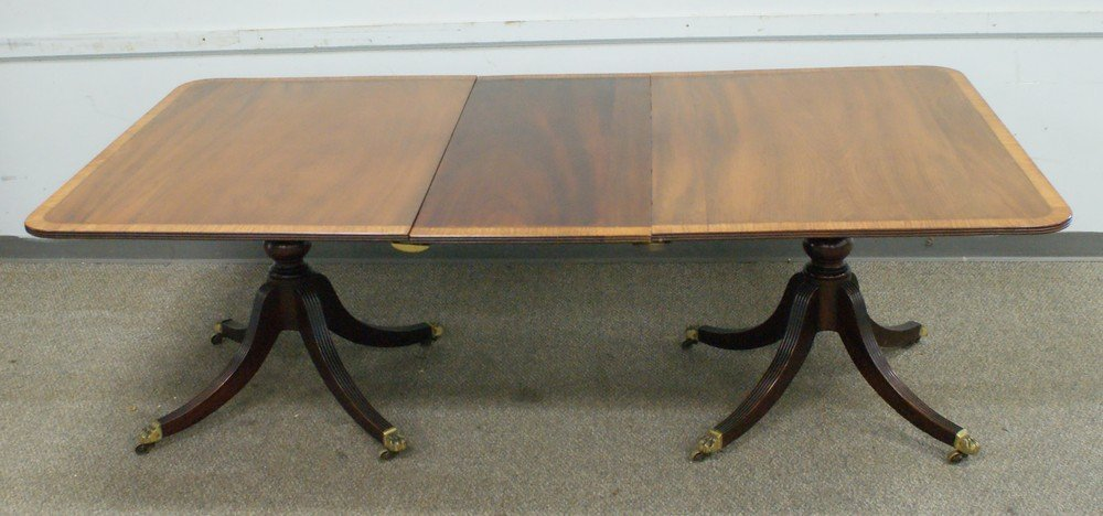 4200A: Mahogany double pedastal dining table, brass paw