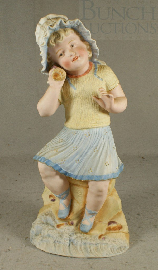 6151: Heubach porcelain figurine of a young girl holdin