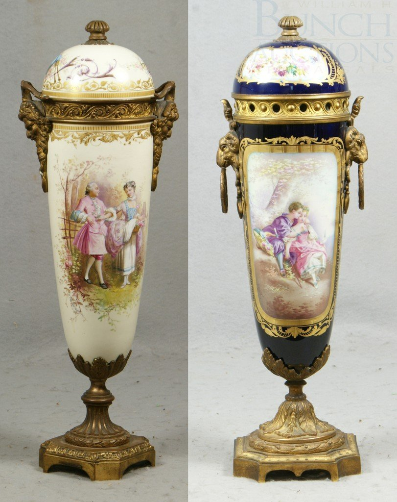 6152: 2 Sevres style porcelain urns with attached lids,