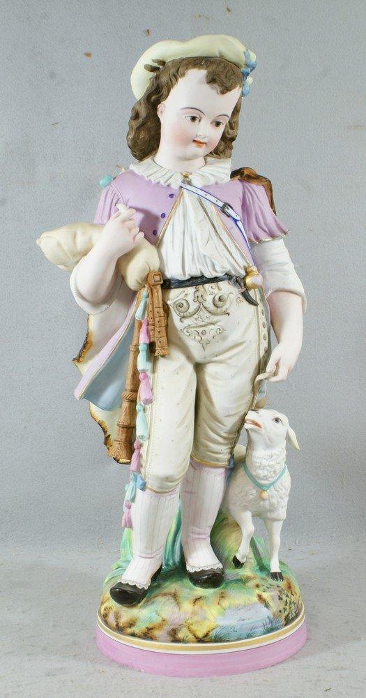 6147: Unmarked French bisque porcelain figurine of a yo