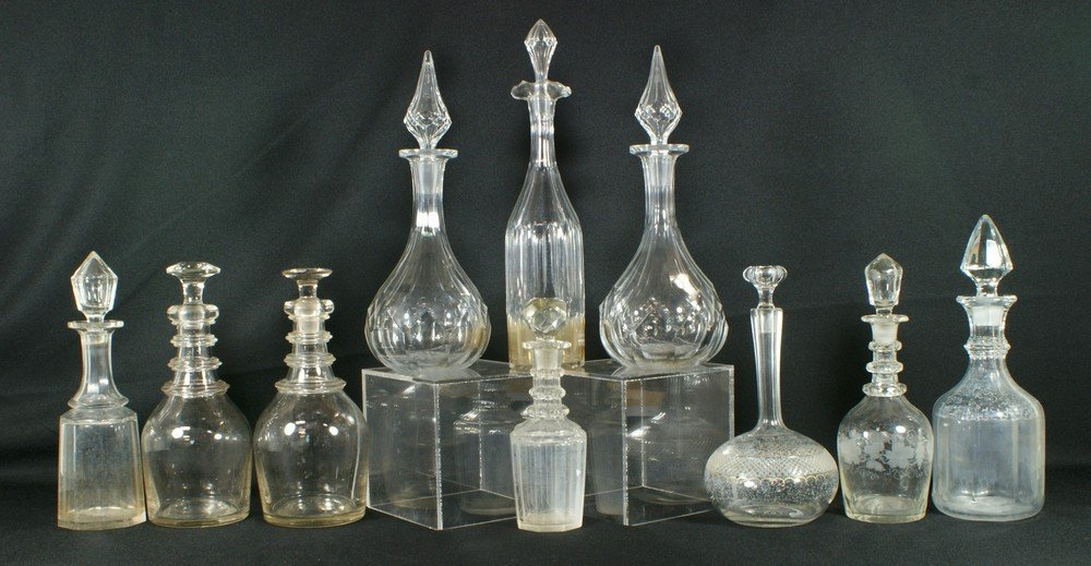 6102: 10 blown glass and other crystal decanters, talle