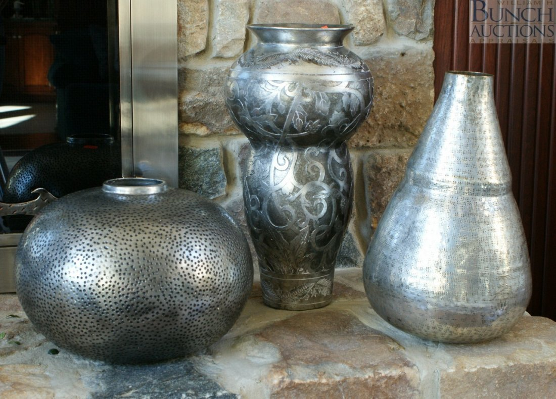 6: Two silver finished ceramic vase with a silver metal
