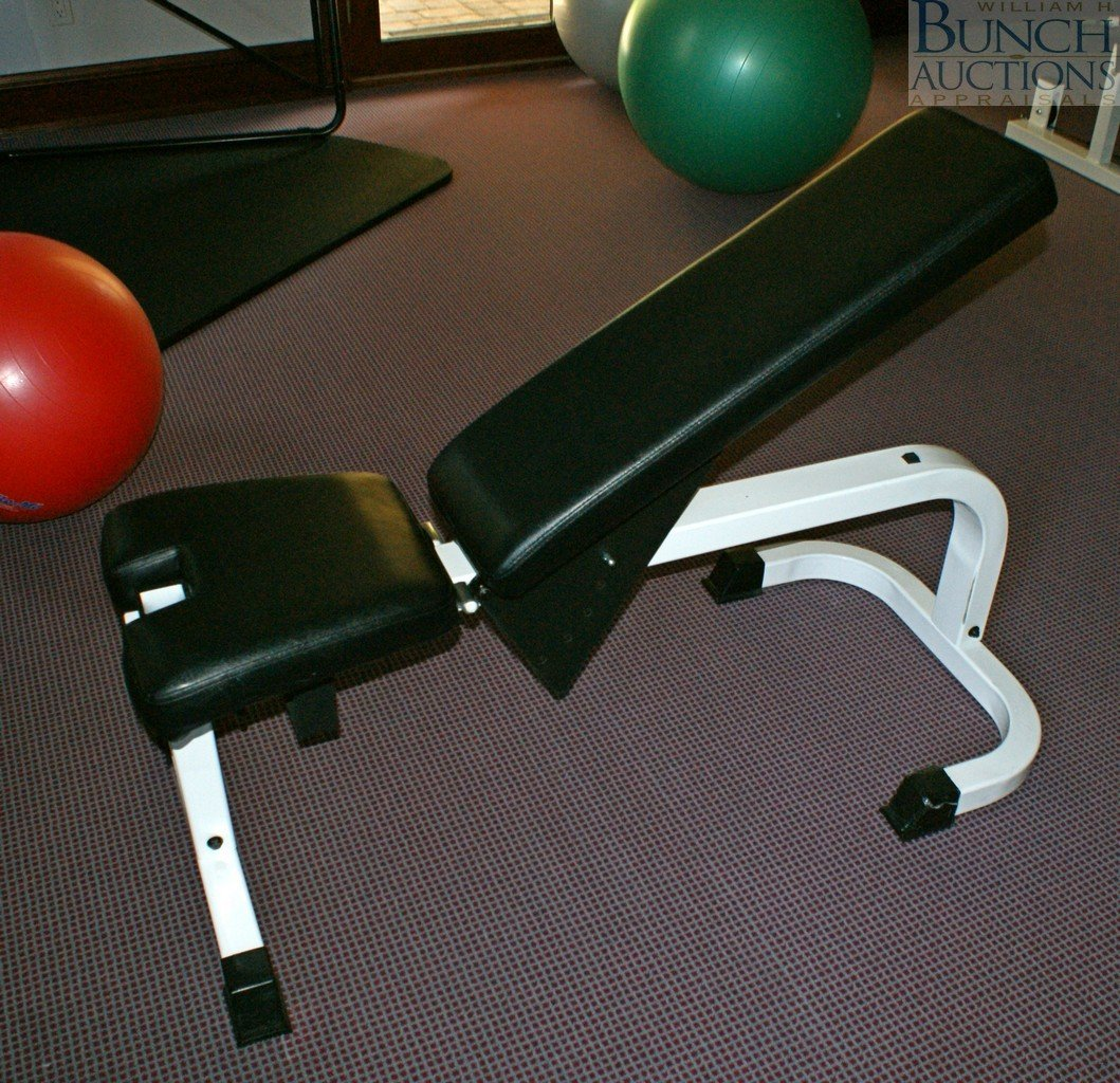 308: Tuff Stuff weight bench with rack and sets of weig
