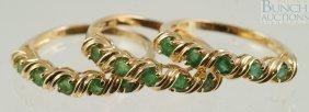 12008: (3) 14K YG ladies rings with green stones, perha