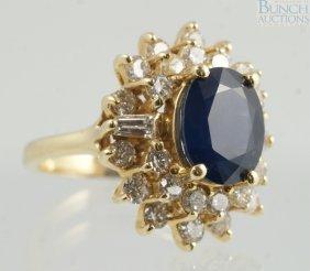 12010: 14K YG diamond & sapphire ladies ring, 10 x 8 mm