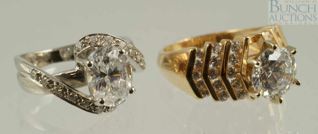 12012: (2) 14K YG & WG ladies rings, set with CZ, size