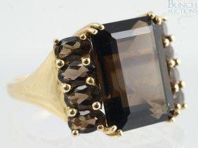 12023: 14K YG emerald cut smoky quartz ladies ring