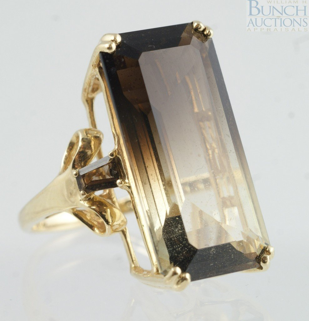 12024: 14K YG ladies ring with emerald cut stone shaded