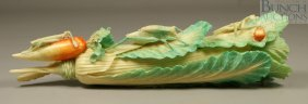 12450: Carved ivory bok choy with various insects, some