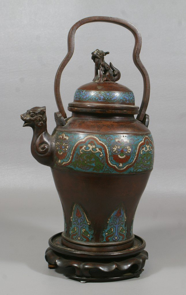 2415: Bronze champlevé tea kettle with foodog finial on
