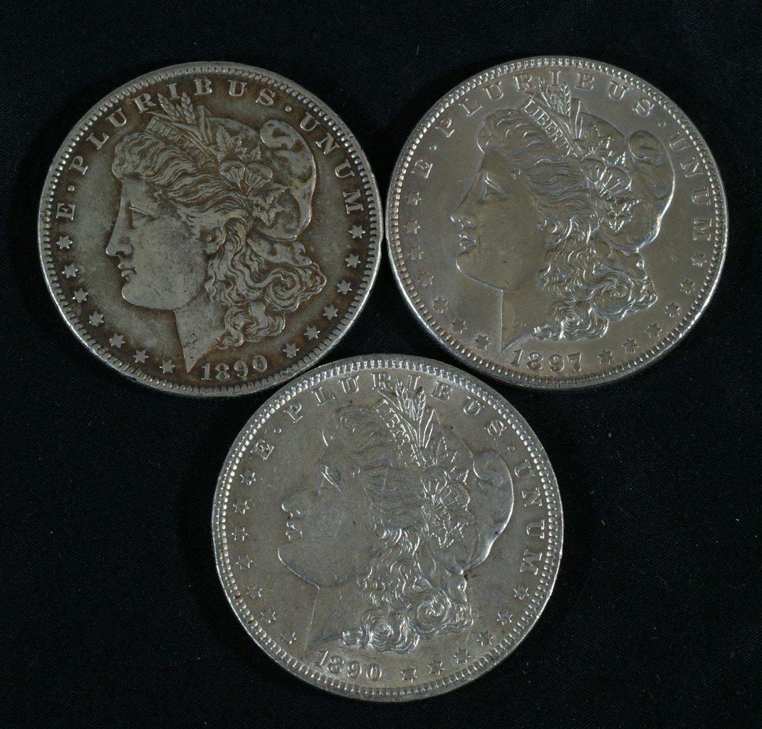 (2) 1890 and an 1897 Morgan dollar, VF to EF
