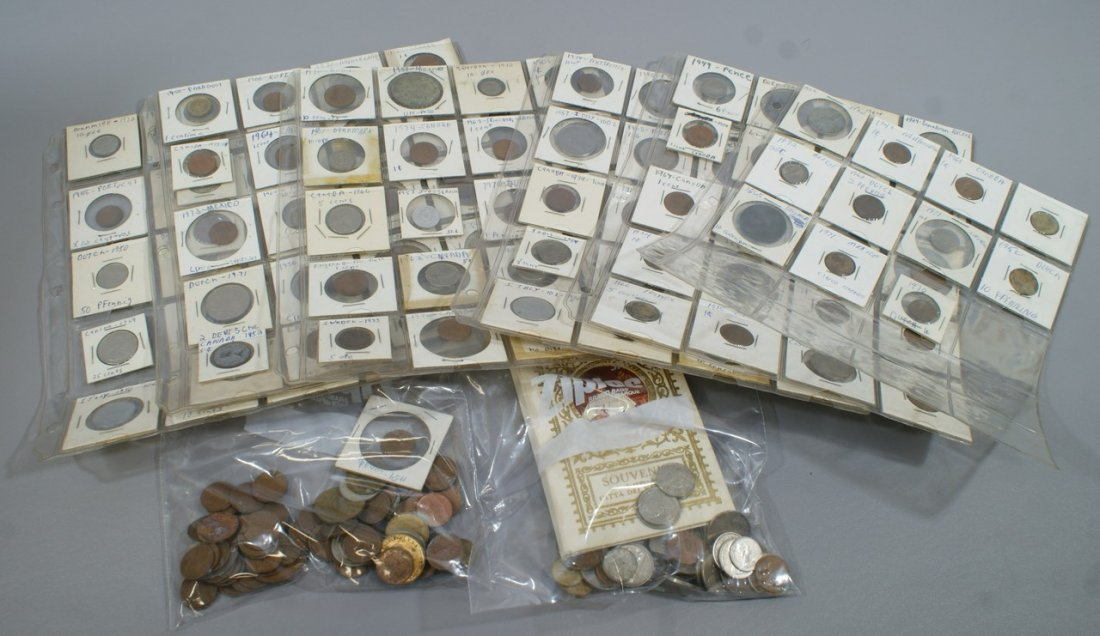 A few hundred mixed foreign coins, loose and in 2 x 2s,