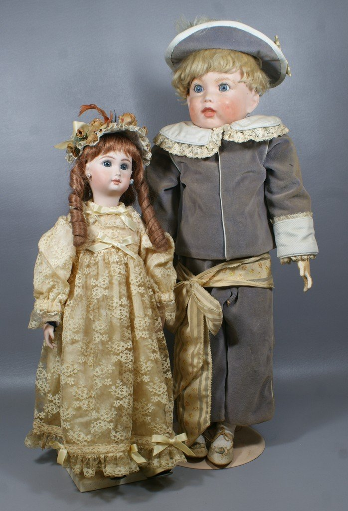 2 Reproduction French Bisque head dolls, the larger of