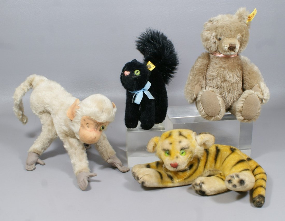4 Steiff Animals, black cat (with ear tag and button mi