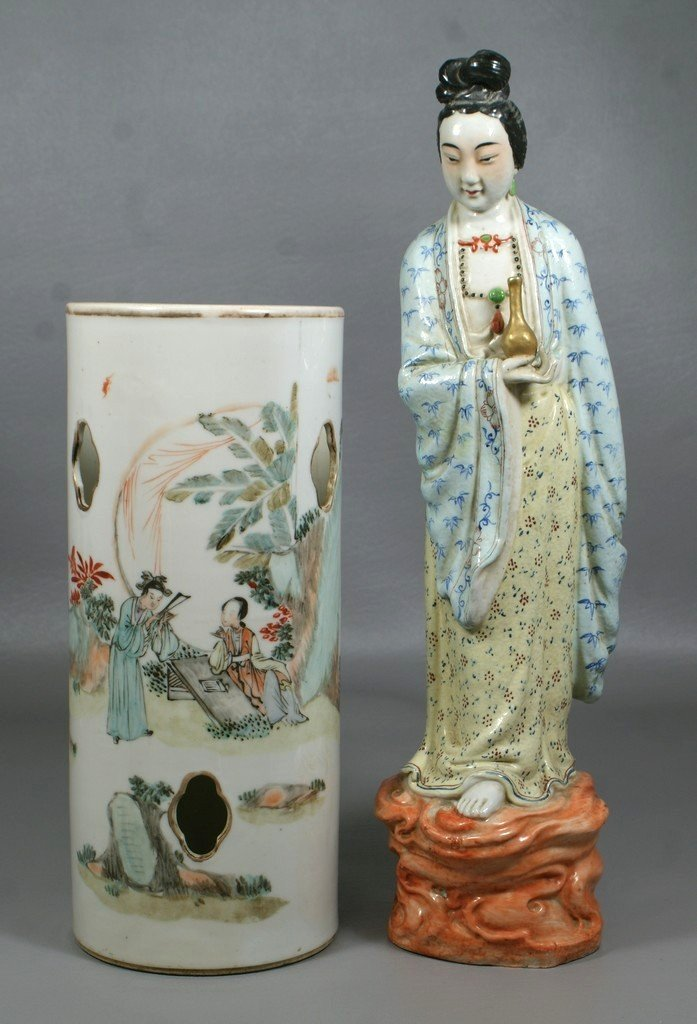 Chinese porcelain figure of a woman holding a vase, 15