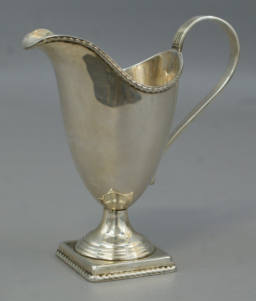 Unmarked American coin silver helmet pitcher, reeded ha