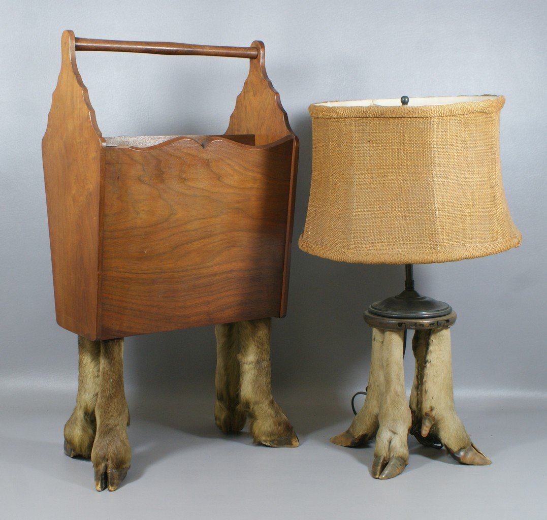 Table lamp and magazine rack with deer hoof foot bases,