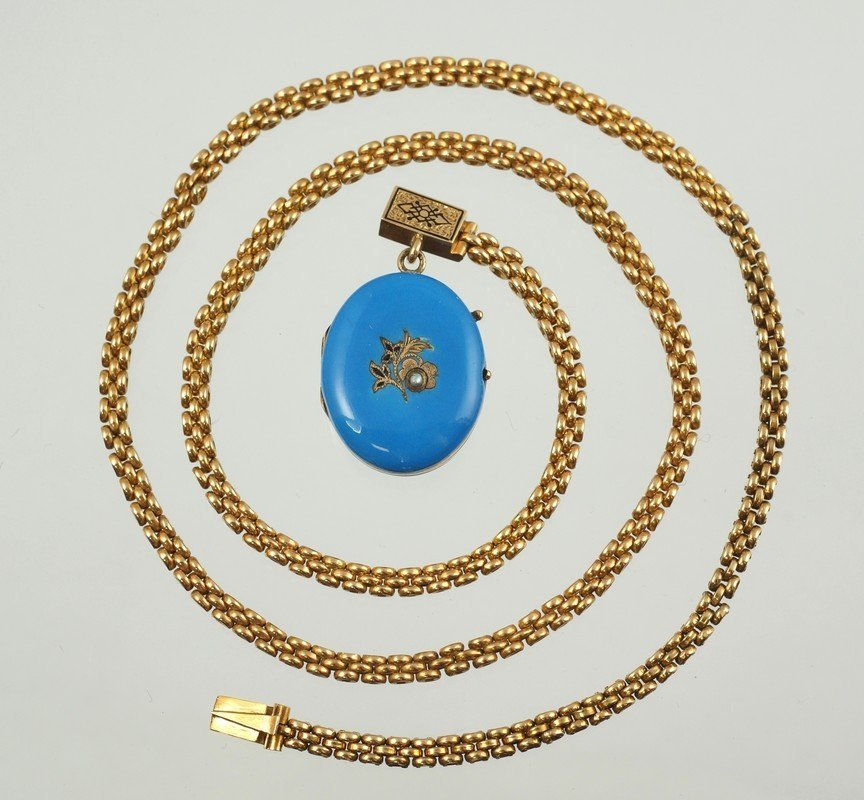 Unmarked YG chain with blue enameled locket, tests 14K,