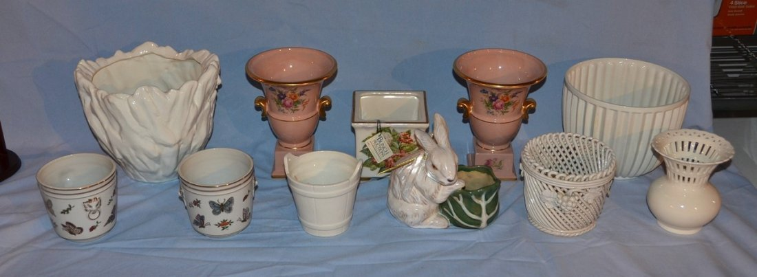 11 assorted planters and cachepots.