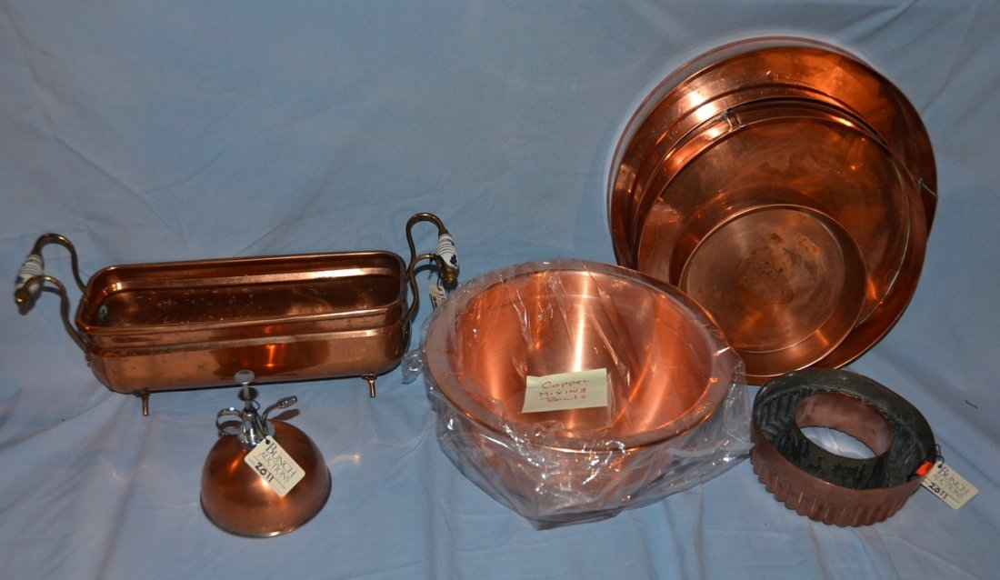 8 pieces of copper, including a footed planter, a cake