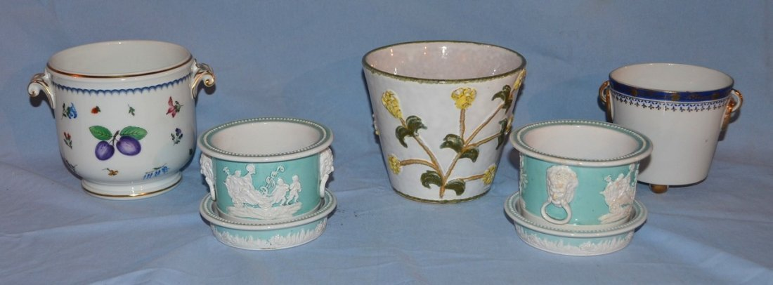 5 porcelain cachepots, including one by Ginori.