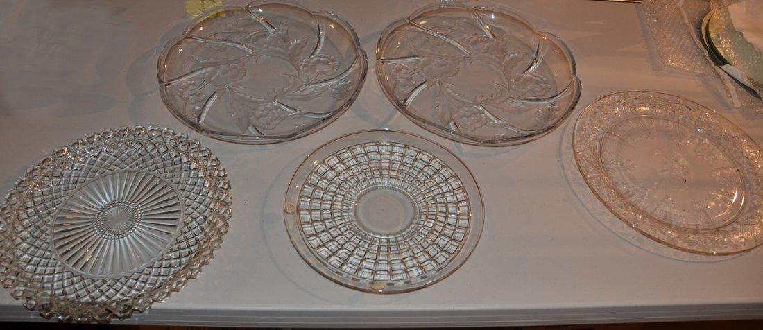 5 round glass trays.
