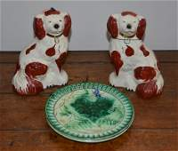 Pair of rust Staffordshire pottery spaniels marked
