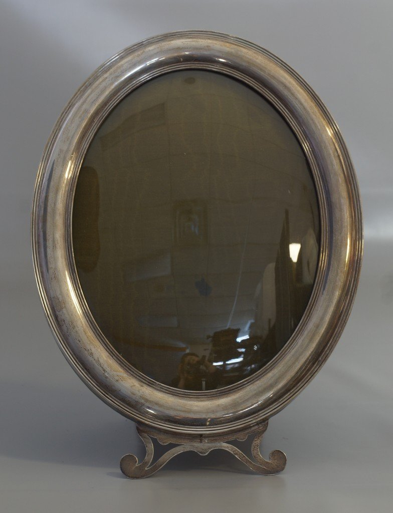 Oval sterling silver frame with easel back, convex