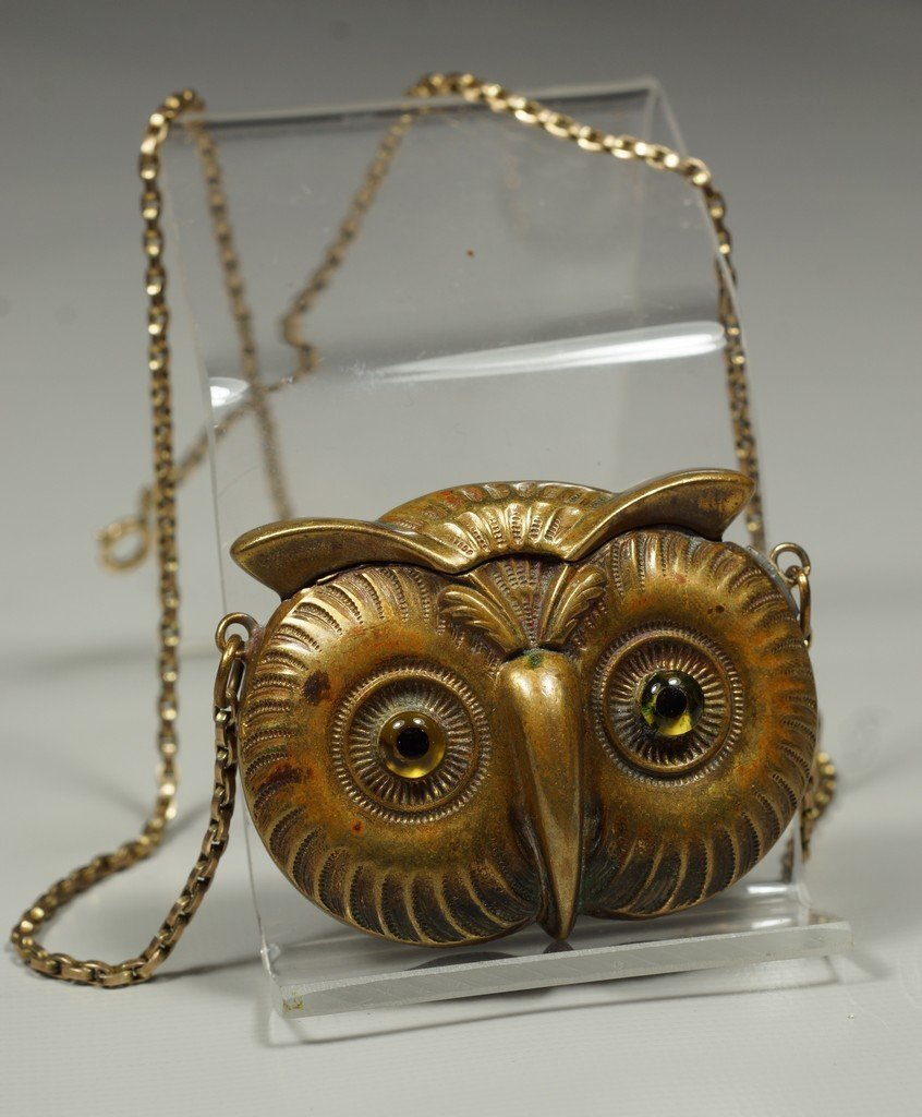 Brass owl head match safe, hinged spring loaded lid,