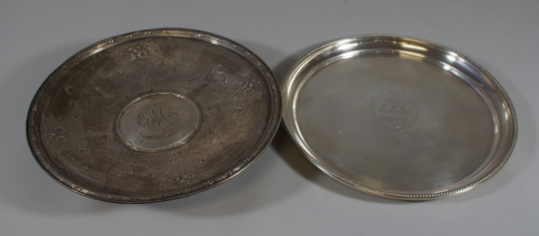 (2) round sterling silver plates, one with coat of