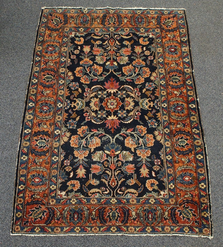 """4'5"""" x 6'6"""" Persian rug, some wear and moth damage"""