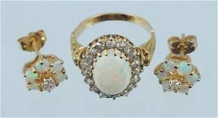 Unmarked 18K YG opal 105 x 75mm  diamond ring size
