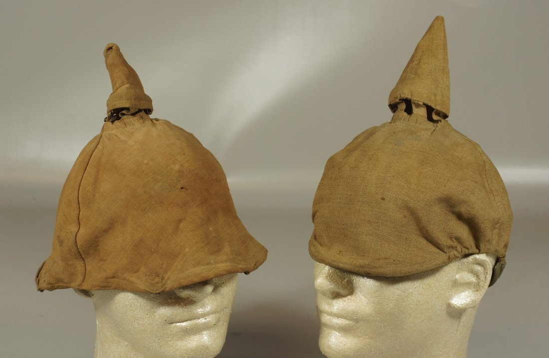 (2) brown pickelhaube covers, one stamped D.R.P. inside