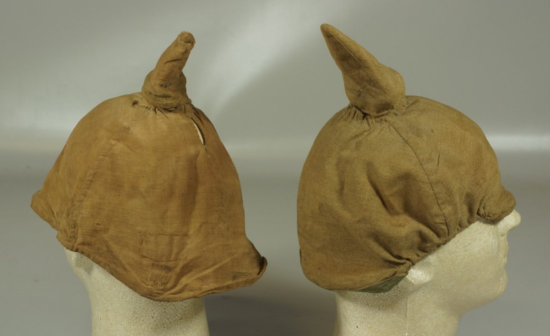 (2) brown pickelhaube covers, one stamped D.R.P. inside - 2