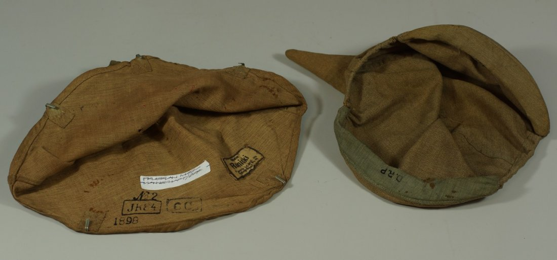 (2) brown pickelhaube covers, one stamped D.R.P. inside - 3