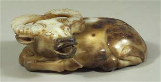 Chinese carved hardstone reclining ox with export seal