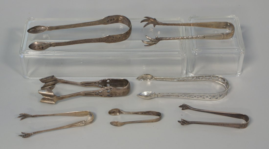 7 pr sterling silver tongs, (2) pr Georgian, others