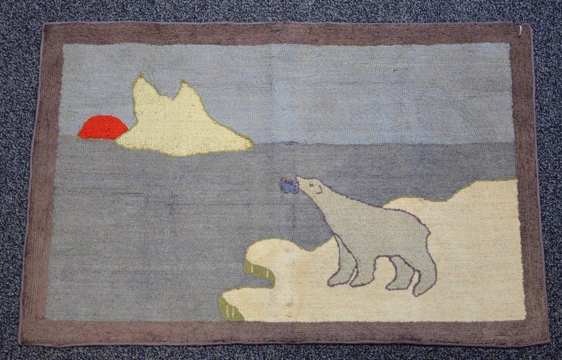 Grenfeld style hooked rug of a polar bear on ice floe,