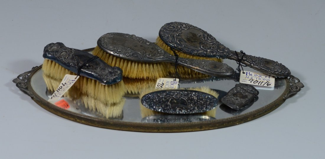4 pc sterling backed dresser set on oval mirrored tray,