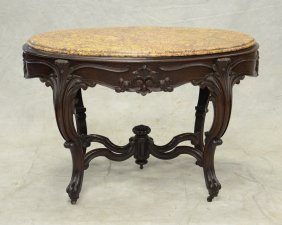 Oval Victorian Carved Walnut Center Table With Brown