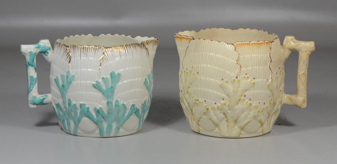 (2) Shell and seaweed Majolica pitchers, one marked