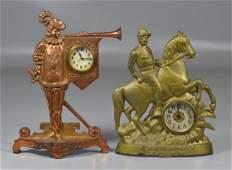 2 Cast iron figural advertising clocks: St. Joseph