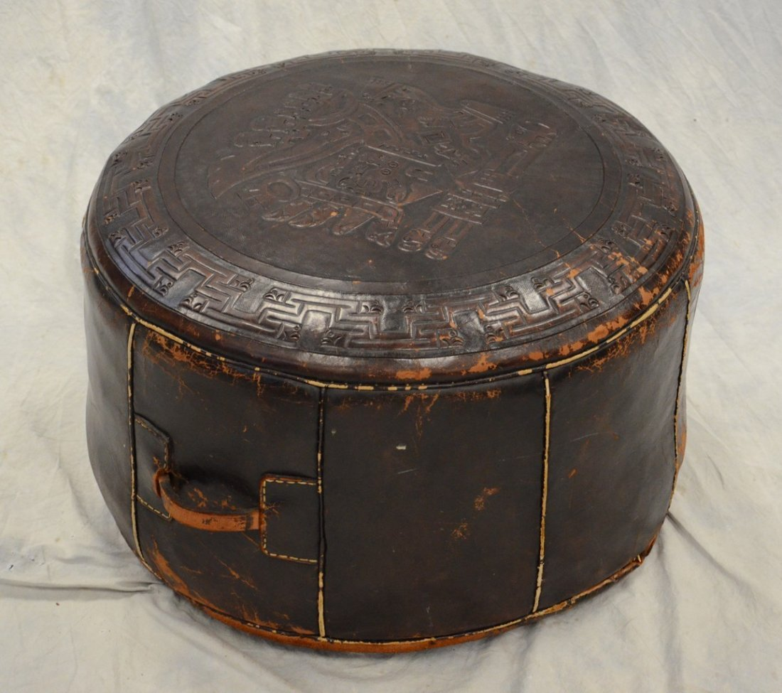 "Embossed leather round ottoman, 22"" diameter, 13"" high,"