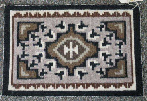 """119: A small Navajo weaving, 11"""" H x 16"""" L. Woven in sh"""