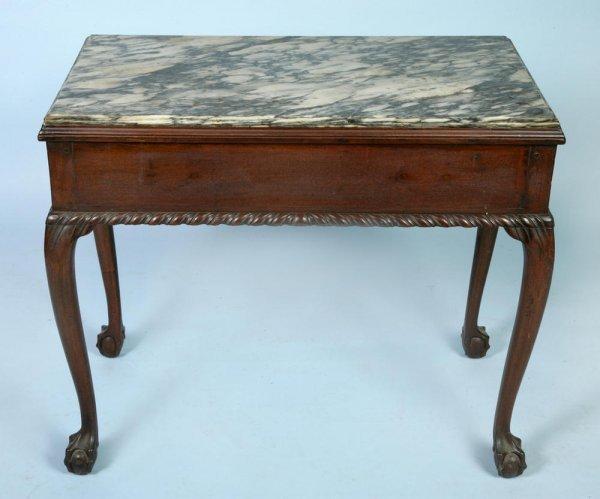 378: English George II period mahogany marble top side
