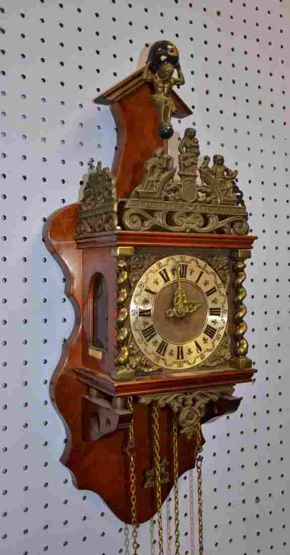 Frieslander-style wall clock with metal mounts, Atlas